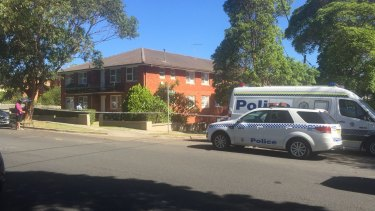 The body of a woman was found at the rear of the property about 1.15pm.