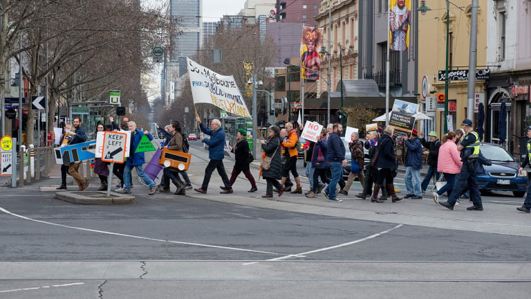 Anti-East West Link protesters gather close to a rally calling for the Andrews government to reinstate the scrapped project.