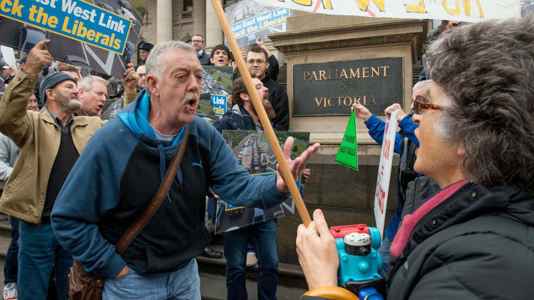Protesters with opposing views of the East West Link argue outside the Victorian Parliament.