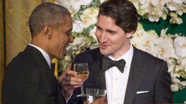 Canadian Prime Minister Justin Trudeau, right, proposes a toast to US President Barack Obama during the state dinner on Thursday.