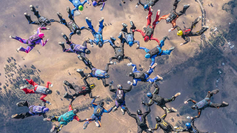 A group of skydivers came together to claim a new national record on Friday.