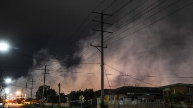 Acrid smoke shrouds the suburb of Dallas last week. More than 115 homes had to be evacuated.