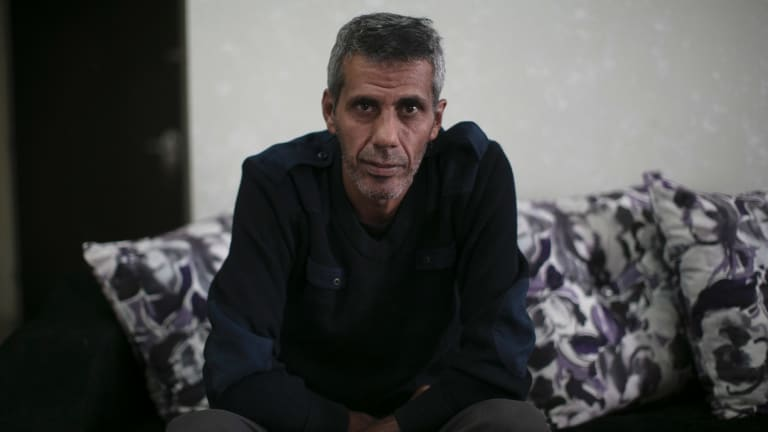 Ayman Ramiyeh, a civil servant, who said he and his wife saved for 20 years to buy their $US140,000 apartment, in the Kufr Aqab neighbourhood of Jerusalem.