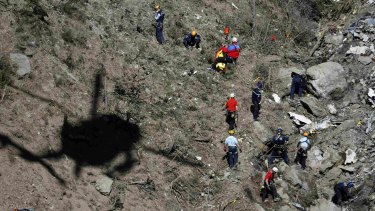 Investigators work amongst debris at crash site of the Germanwings flight.