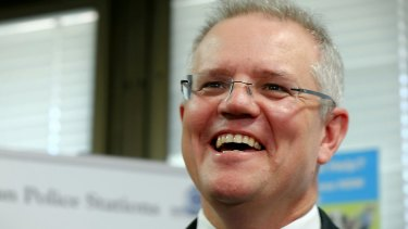 Federal Treasurer Scott Morrison has been warned he will put Australia's triple-A credit rating at risk if the budget pursues only limited spending cuts and doesn't do much to collect more tax.