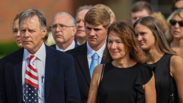 Fred and Cindy Warmbier, front row, watch as the casket for their son Otto is placed in a hearse after his funeral in Wyoming, Ohio in June.