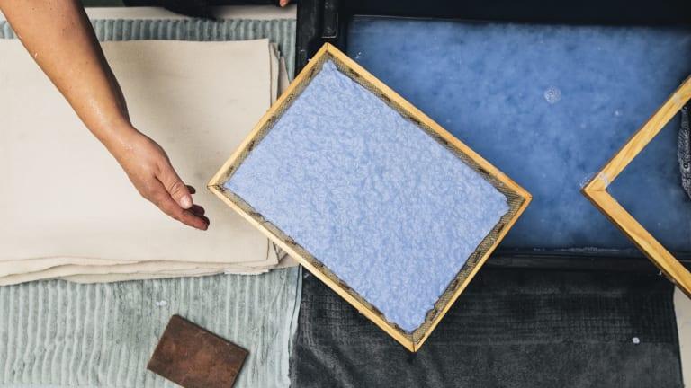 Artisan Sarah Sadler of Griffith making paper from old denim at Paperworks in Watson.