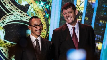 Billionaire Lawrence Ho and James Packer before the opening of Melco's Studio City casino resort in Macau.