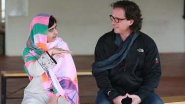 Malala with filmmaker Davis Guggenheim in LA this year.