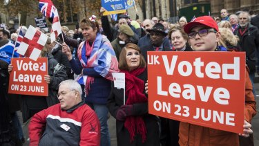 Pro-Brexit demonstrators outside the Houses of Parliament in London on Wednesday called for Prime Minister Theresa May to move forward with EU exit formalities.