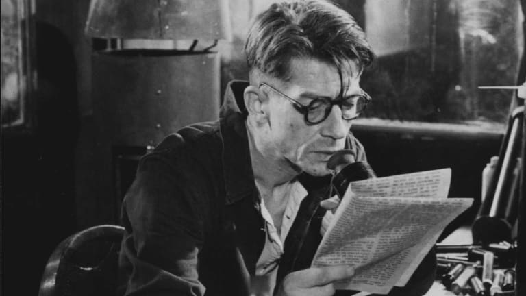 "Winston (actor John Hurt) at work in the Ministry of Truth where he re-writes history. From the British film ""1984"" (1984)."
