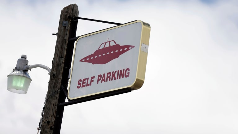 A sign indicates UFO parking at the Little A'Le'Inn, located 15 kilometres up the road from the military testing base known as Area 51, in Rachel, Nevada.