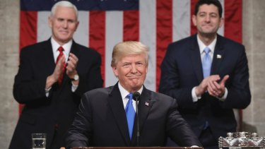 US President Donald Trump delivers his first State of the Union address on January 30 as Vice-President Mike Pence and House Speaker Paul Ryan applaud.
