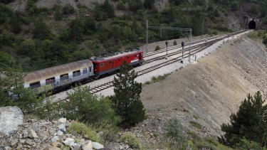 Rail journey: A train leaves the railway station near the village of Strpci in eastern Bosnia.