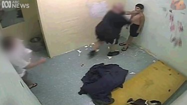 Dylan Voller being manhandled by staff at the Darwin facility.