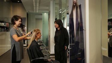 Sandy Chong (right), chief executive of the Australian Hairdressing Council, at her salon, Suki.