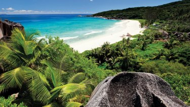 A beach in the Seychelles where TitanTrade website operator One Tech Media is located.