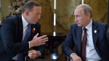 Australian Prime Minister Tony Abbott speaks with Russian President Vladimir Putin at the APEC leaders' summit in Beijing.