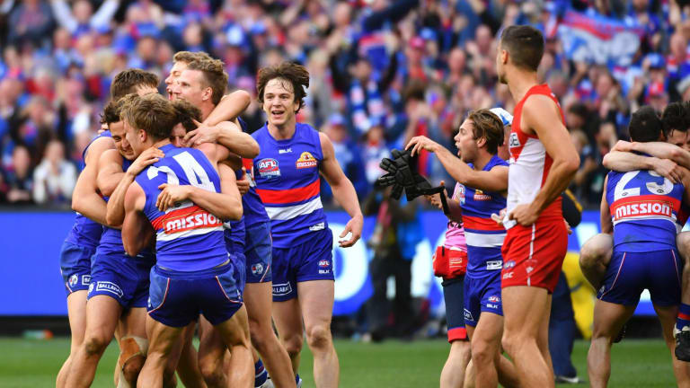 That day last year: Bulldogs players celebrating the grand final win over the Swans.