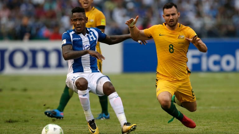 Australia's Baily Wright fights for the ball against Honduras' Romell Quito in their World Cup qualifier in San Pedro Sula, Honduras.