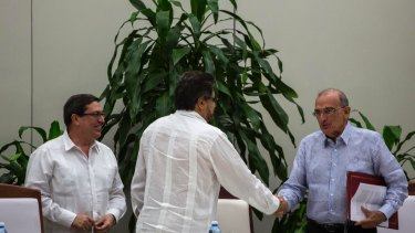 Humberto de La Calle, right, head of Colombia's government peace negotiation team, right, shakes hands with Ivan Marquez, chief negotiator of the Revolutionary Armed Forces of Colombia, or FARC in Havana, Cuba.