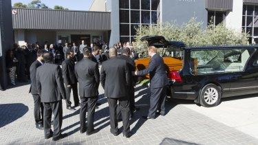 The coffin of Myuran Sukumaran is taken into church.