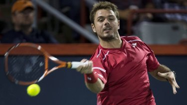 Fiery encounter: Stan Wawrinka returns to Nick Kyrgios at the Rogers Cup.