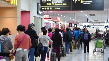 Long queues at Melbourne Airport earlier this year.