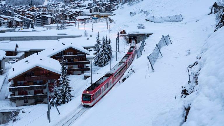 The first passenger train is leaving the train station towards Taesch, in Zermatt, Switzerland.