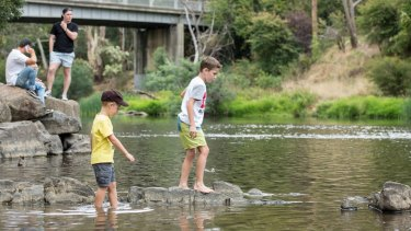 William and Samuel Egan, of Ferntree Gully, enjoy the Yarra River at Warrandyte Bridge