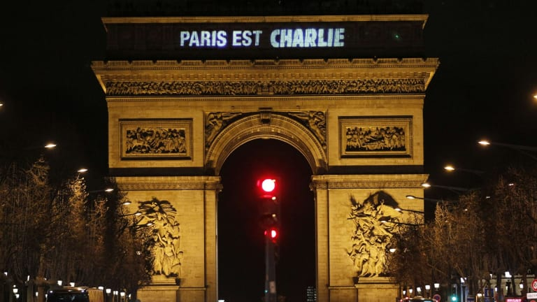 """The message: """"Paris is Charlie"""" is projected on the Arc de Triomphe in tribute to the victims of the deadly attacks that rocked France."""