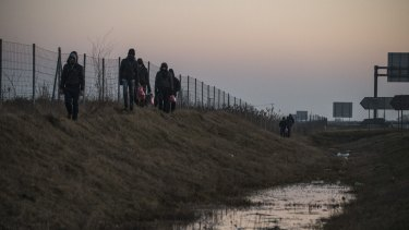 Migrants make their way along a ditch near the border with Hungary, outside Subotica, Serbia, earlier this year.