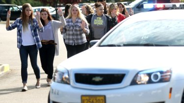 Students and staff are evacuated after a deadly shooting.