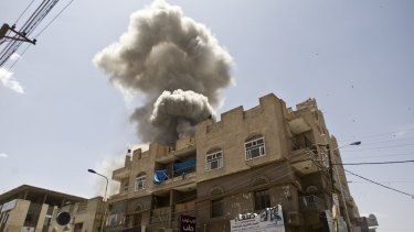 Smoke rises from a house of former Yemeni president Ali Abdullah Saleh after a Saudi-led airstrike in Sanaa, Yemen.