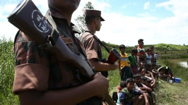 """Several hundred Rohingya trying to flee Myanmar got stuck in a """"no man's land"""" at one border point barred from moving farther by Bangladeshi border guards."""