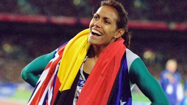 Cathy Freeman celebrates gold in the Womens 400m Final at the Sydney Olympic Stadium.