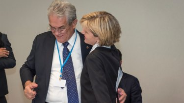 That was then: Foreign Minister Julie Bishop hugs then Marshall Islands minister Tony de Brum at the Paris climate summit.