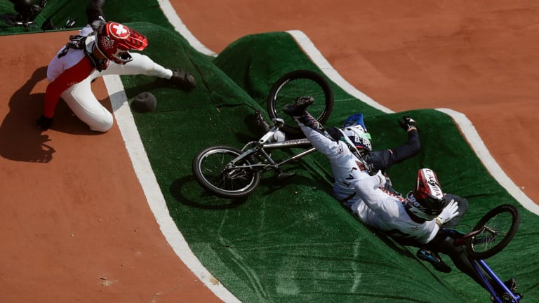 David Graf of Switzerland, left, and Maris Strombergs of Latvia, right, fall during the BMX cycling quarter-finals .