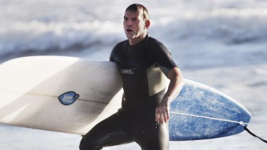 "Tony Abbott, pictured surfing in 2014, went to hospital for a ""couple of stitches"" after encountering rough surf conditions on Friday morning."