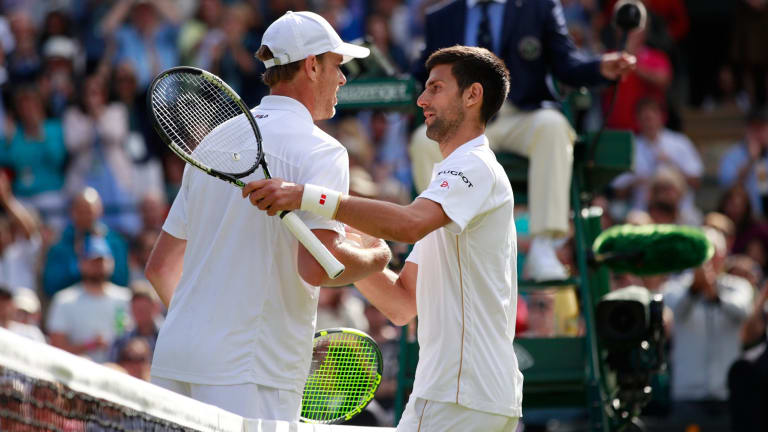Querrey shakes hands with Djokovic following his victory.