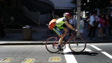 Cyclists on King Street at the corner of Castlereagh Street in Sydney.