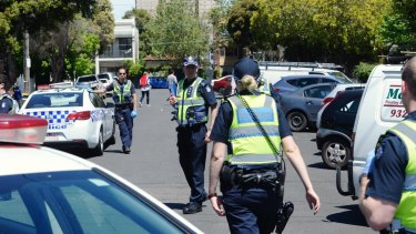 "Residents said six police cars plus ""Department [of Human Services] people, Yarra [council] people,"" descended on Bendigo Street on Friday."