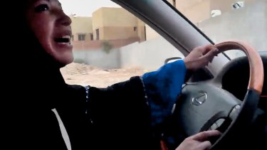June 2011: a Saudi Arabian woman drives a car in the capital Riyadh in defiance of the kingdom's prohibition.