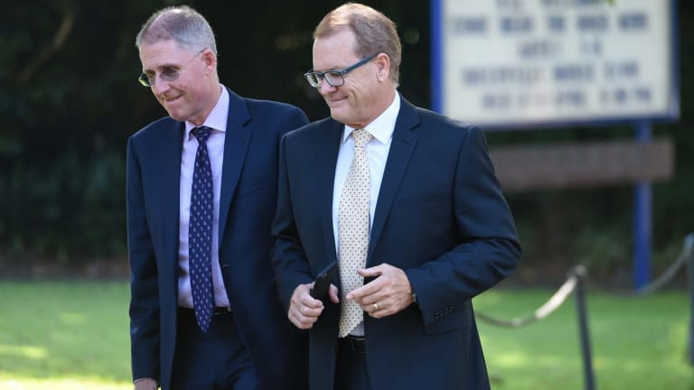 Scots College principal Ian Lambert, right, on his way to Wednesday's meeting.