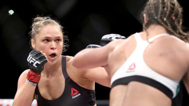 Rousey (in black top) fighting Brazil's Bethe Correia in Rio de Janeiro in August. She knocked out Correia in 34 seconds.