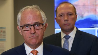 Prime Minister Malcolm Turnbull says Immigration Minister Peter Dutton (right) has suffered constant, often vicious attacks.