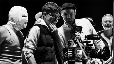 director Abe Forsythe (second from left) watches a take with actor Justin Rosniak, director of photography Lachlan Milne and stunt co-ordinator Tony Lynch.