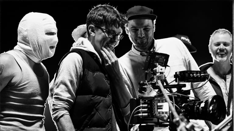 On set  ... Abe Forsythe (second from left) watches a take with actor Justin Rosniak, director of photography Lachlan Milne and stunt co-ordinator Tony Lynch.
