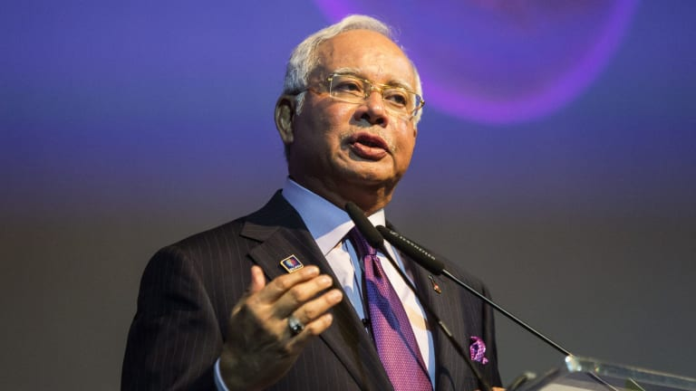 Prime Minister Najib Razak speaking at the Invest Malaysia Conference in Kuala Lumpur last year. Critics of the new 'death by stoning' law are concerned it may frighten investors.
