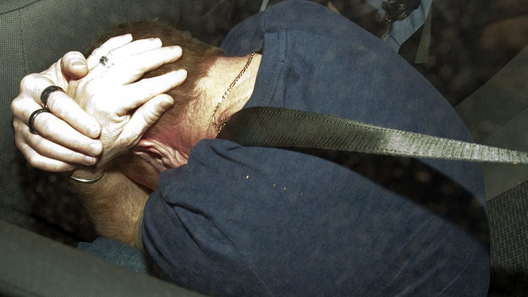 Criminal history: Adrian Bayley being driven away by homicide detectives after being arrested.